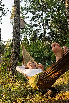 Woman relaxing on hammock - p312m1229275 by Fredrik Schlyter