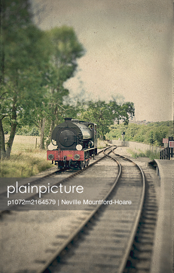 Single stream train on tracks - p1072m2164579 by Neville Mountford-Hoare