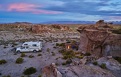 Recreational vehicle, travelling at dusk, Oruro, Oruro, Bolivia, South America - p429m1557359 by Stephen Lux