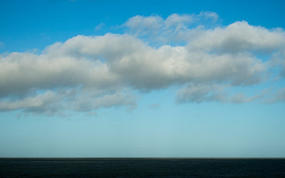 Clouds over the sea - p1132m2027966 by Mischa Keijser