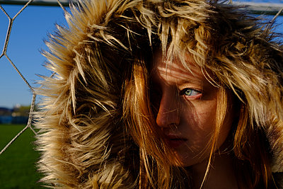 Portrait of a girl in jacket with fur on hood - p1363m1332315 by Valery Skurydin