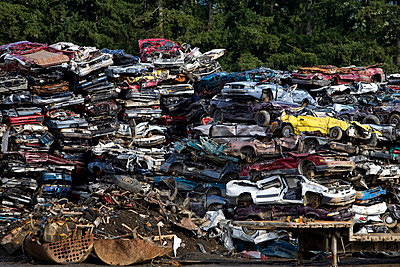 Vancouver Island, British Columbia, Canada; Crushed vehicles at a recycling plant - p4429595f by Design Pics