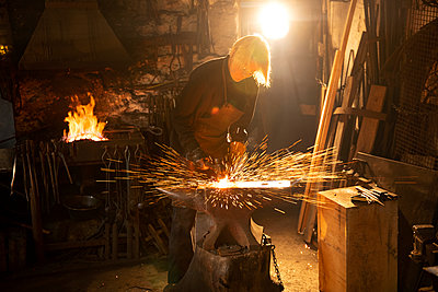 Female blacksmith working in workshop - p1023m2200943 by Himalayan Pics