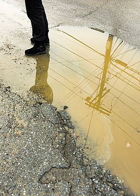 Reflection of pylon in a puddle - p758m2181750 by L. Ajtay