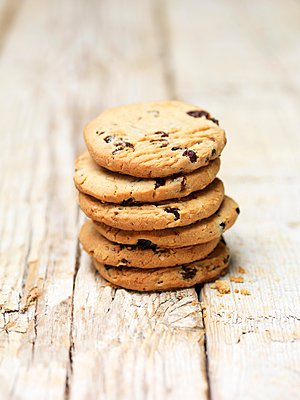 Stack of blueberry and oat cookies on wood - p429m1095604f by Diana Miller