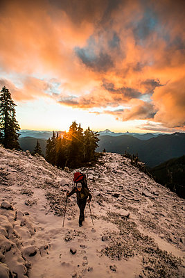 Backpacker hiking mountain ridge after a storm, squamish, B.C. - p1166m2255900 by Cavan Images