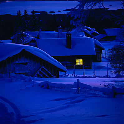 Cottages covered with snow in winter at night - p3484700 by Greatshots