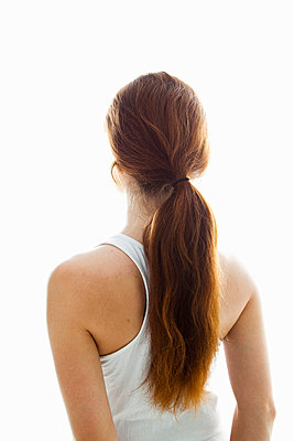 Girl with long hair in ponytail - p4265609f by Tuomas Marttila