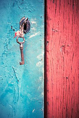 Key in old wooden door - p528m718598f by Dan Lepp