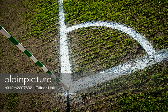 Corner white lines on soccer pitch - p312m2207632 by Ellinor Hall