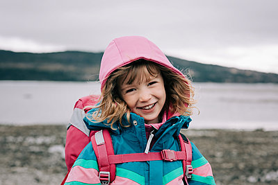 close up candid portrait of young girl laughing whilst hiking - p1166m2190884 by Cavan Images