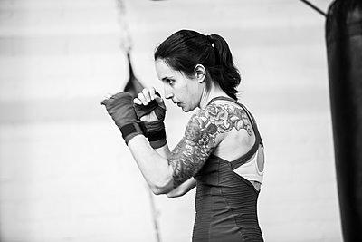 Caucasian boxer training in gymnasium - p555m1409560 by Shestock