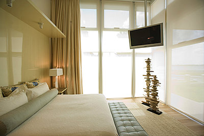 Luxury hotel room with large bed and widescreen television - p6242995f by Frederic Cirou