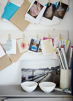 Knitting needles with postcards on pegboard - p349m789914 by Brent Darby