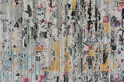 Full frame shot of peeling posters on weathered wall - p301m1498858 by Halfdark