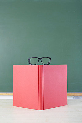 Red book and glasses - p4641754 by Elektrons 08