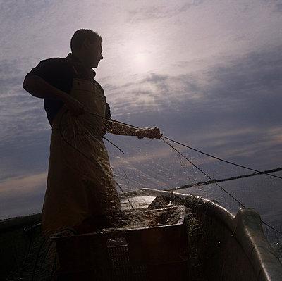 Fisherman at work - p7090013 by Axel Kohlhase