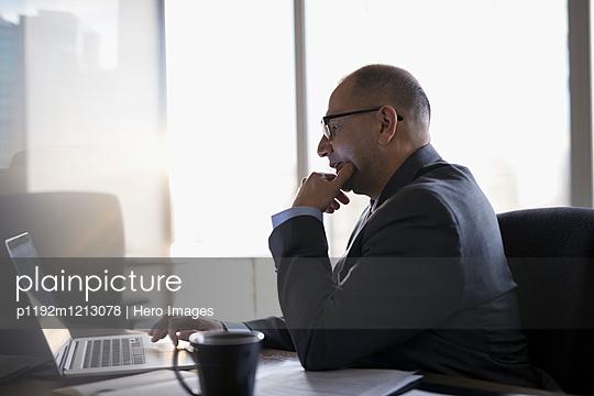 Male lawyer using laptop in office