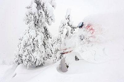 Skifahrer skiing through the deeply snowed in forest, Kaltenbach, Zillertal, Austria - p1316m1202841 by Michael Neumann