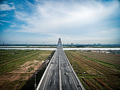 Aerial view of Nhat Tan bridge in Hanoi, Vietnam, Southeast Asia - p934m1451291 by Francis Roux photography