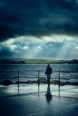 Teenager girl winter rain promenade stormy weather - p609m1490717 by WRIGHT