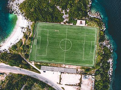 Football field on the coast, Corfu - p1326m2160887 by kemai