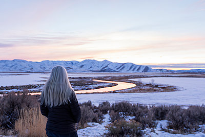 Mature woman by river during winter in Picabo, Idaho - p1427m2109964 by Steve Smith