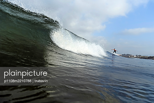 Young woman riding a wave, Bali - p1108m2210788 by trubavin