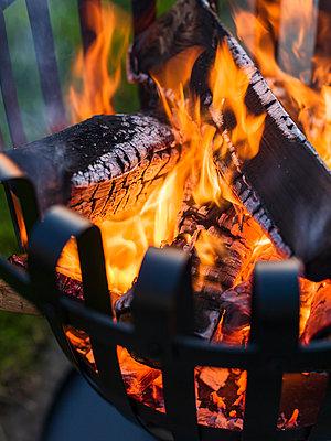 Sweden, Skane, Brazier with burning wood - p352m1141959 by Carolina Romare