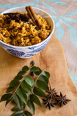 Flavoured rice in a bowl - p1655m2253511 by lindsay basson