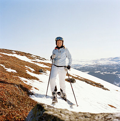 A woman skiing Sweden - p5281575f by Lars Wallin