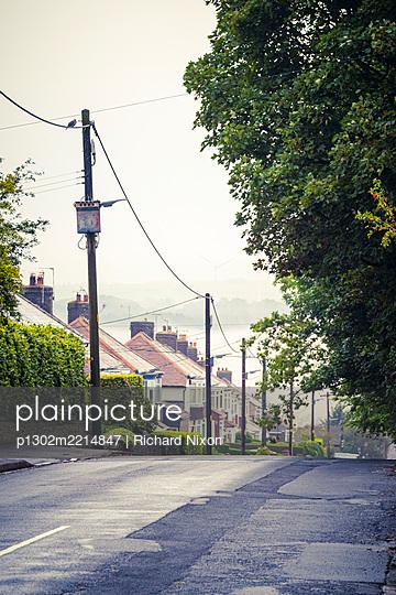 A suburban street of semi detached houses - p1302m2214847 by Richard Nixon