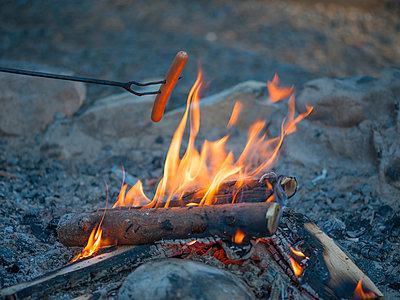 Sausage over campfire - p300m998422f by Jan & Nadine Boerner