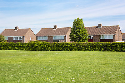 Housing estate and football field III - p1057m903772 by Stephen Shepherd