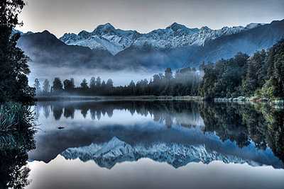 Lake Matheson reflection with predawn winter light on Mount Tasman and Mount Cook - p884m863215 by Colin Monteath/ Hedgehog House