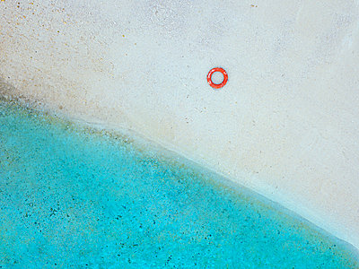 Inflatable ring on shore at beach - p300m2240821 by Konstantin Trubavin
