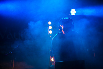 DJ performing at a summer festival - p1057m1496703 by Stephen Shepherd