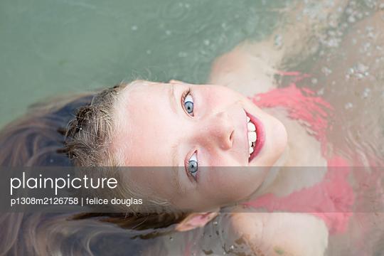 Girl in water - p1308m2126758 by felice douglas
