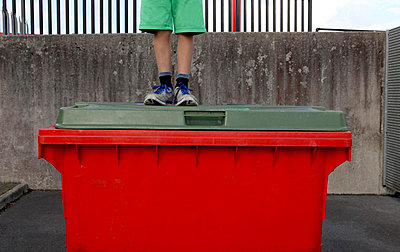 Boy On Red Bin - p1082m833781 by Daniel Allan