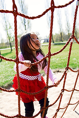 Little girl on a playground - p300m1023390f by Gabi Dilly