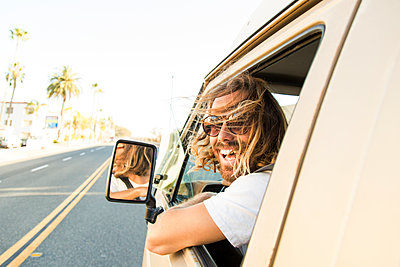 Portrait of cheerful man in mini van on road - p1166m1145147 by Cavan Images
