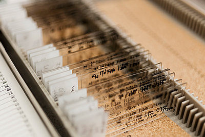 Close-up of various microscope slides in container at laboratory - p301m1498725 by Patrick Strattner