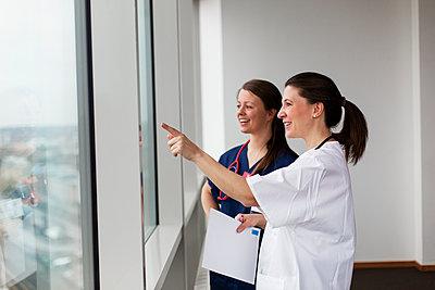 Female doctors in hospital - p312m2174353 by Scandinav