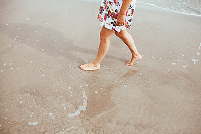 Walking barefoot on the beach - p1006m1425236 by Danel