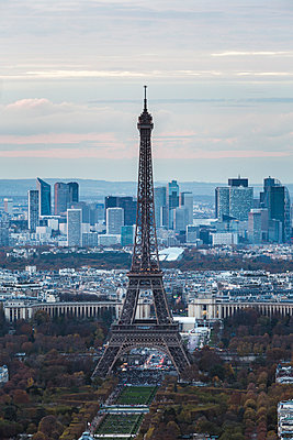 High angle view of Eiffel Tower against sky in city during sunset - p1166m1230503 by Cavan Images