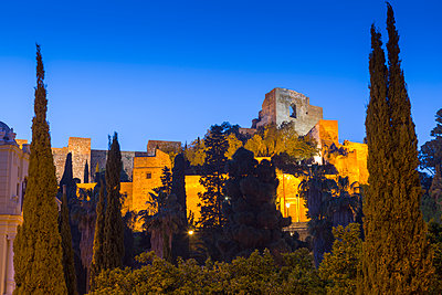 Illuminated view of the walls of Alcazaba, Malaga, Costa del Sol, Andalusia, Spain, Europe - p871m1480377 by Frank Fell