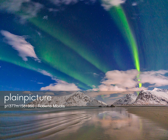 Northern Lights illuminate Skagsanden beach and the snowy peaks - p1377m1581950 by Roberto Moiola