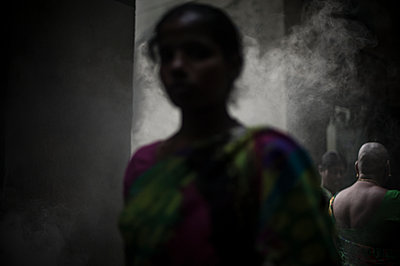 Woman in the smoke - p1007m1144289 by Tilby Vattard