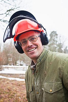 Man with protective helmet - p4267948f by Katja Kircher