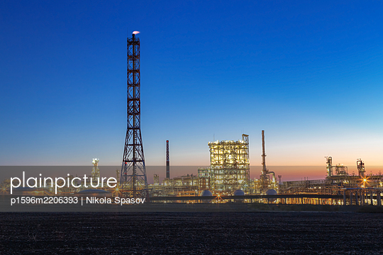 Oil refinery at night - p1596m2206393 by Nikola Spasov